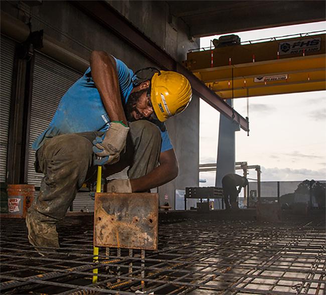 Man manufacturing precast concrete