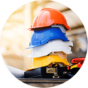 Colorful hard hats stacked