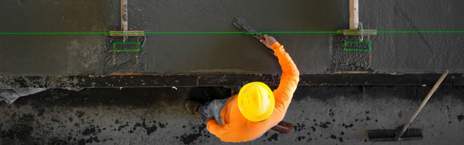 worker using laser-guided technology with precast