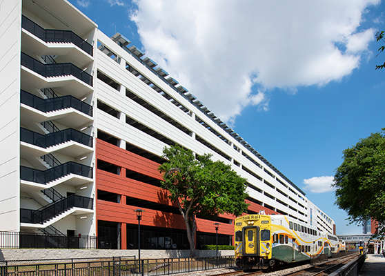 McRae Ave Garage with Sunrail Passing By